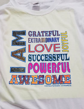I Am Awesome Workshop Tee Shirt image in brown, orange and pink